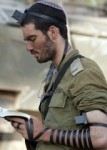 Israeli soldier praying