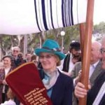women woman carrying sefer torah